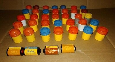 Lot of 35 empty Kodak film canisters with 4 used film rolls