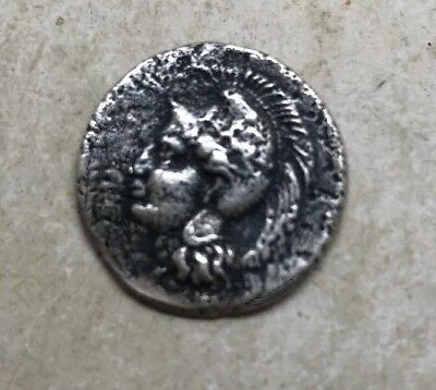 Ancient greek silver coin with head of athena