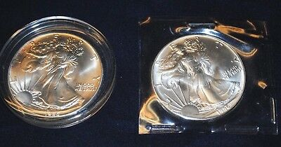 (2) ~ 1986 American Eagle Walking Liberty 1 oz. Silver Dollars BU  Toned