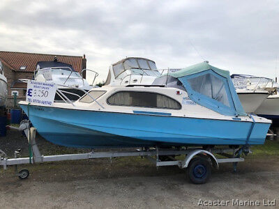Shetland cabin cruiser / boat fitted with a Yamaha outboard engine