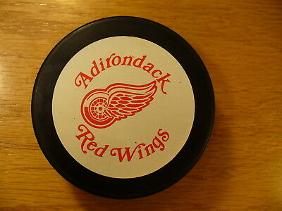 AHL Adirondack Red Wings Lg Wht Bckgrnd Souvenir Logo Hockey Puck Collect Pucks