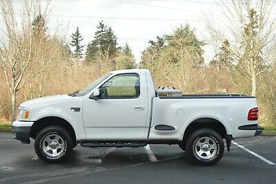 1999 Ford F-150  1999 FORD F150 SINGLE CAB FLARESIDE 4X4 SHORT BED 5.4L V8 ONLY 25,965 MILES!!!