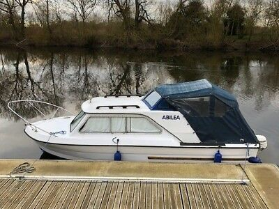 20ft Cabin cruiser / boat with  15hp 4 stroke outboard petrol engine.