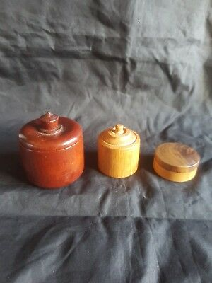 Three Wooden Treen Pots one signed swampy gum 1984.