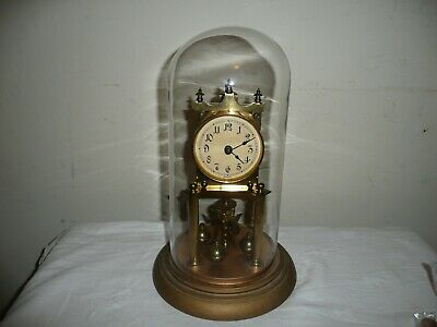 Huber Uhren Anniversary Clock in Glass Dome, Serial 37143 Good Condition.