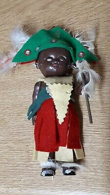 Vintage Tiny Black baby doll in African Costume Plastic