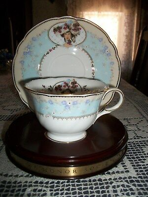 Avon Honor Society 1998 Cup and Saucer w/Wood Stand Bone China  By Nikko  Japan