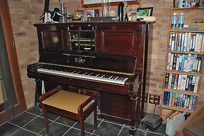 Steinway Piano/Pianola with collection of pianola rolls