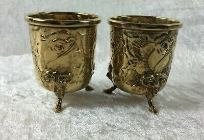 pair of sterling vermeil footed cups, dec. w/ roses and ram heads