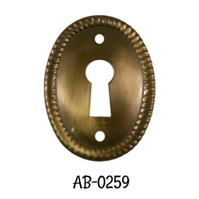 Antiqued Keyhole Stamped Brass Oval Vertical Keyhole Cover with Rope Edging