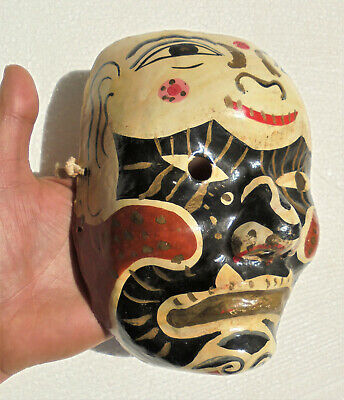 Old Chinese or Japanese traditional mask made in papier-mache