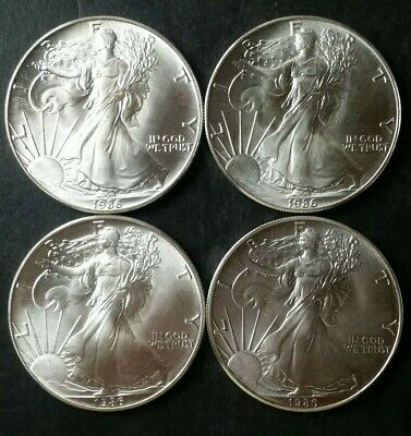 Lot of Four 1986 $1 American Silver Eagle Dollars