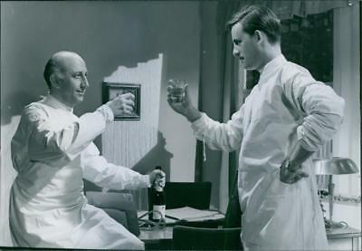 """Separate Entrance and a man in a scene from the 1956 Swedish drama film, """"Separa"""