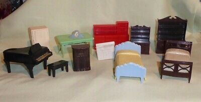 A collection of 1950's  vintage dolls house furniture