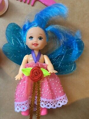 Small dolls, barbie and fairy dolls with birthday cake and accessories
