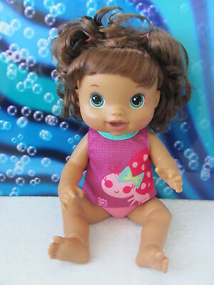 Baby Alive ~ 2011 Hasbro ~ Brown hair with teal (green/blue) eyes doll