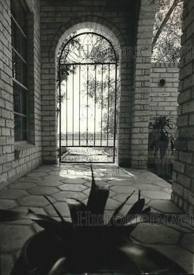 1965 Press Photo House with Wrought Iron Gate, Brick Arches and Terra Cotta Tile
