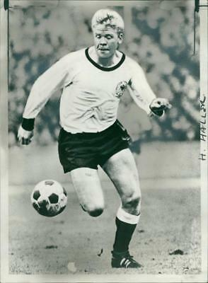 Helmut Haller about to kick the ball for the goal - Vintage photo