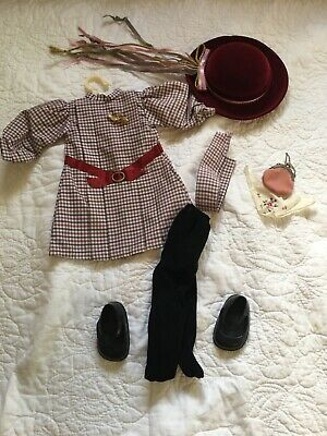 american girl doll samatha. Doll and 9 outfits. Gently used but has a few stain