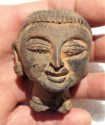 BURMA: Old Burmese head carved in stone