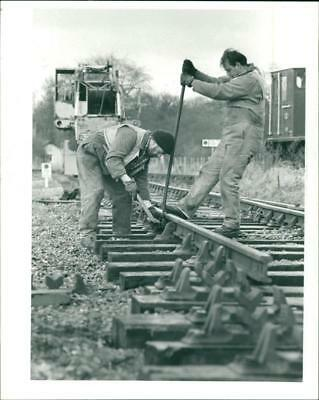 Two man fixing the railway at North Elmham. - Vintage photo