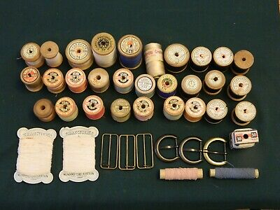 Vintage wooden reels of cotton, buckles & other haberdashery.