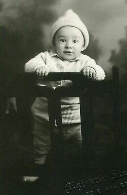 RPPC DARLING CHILD w KNITTED HAT ANTIQUE STUDIO REAL PHOTO POSTCARD WATERLOO IA