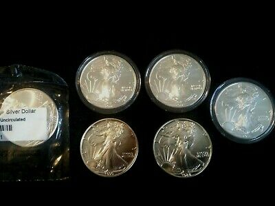 Lot of 6 BU Silver American Eagle Dollars. 1988, 1990, 2009, & 3 each 2011.