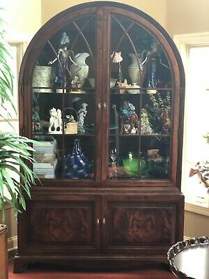 Antique wood display cabinet with glass and curved at top