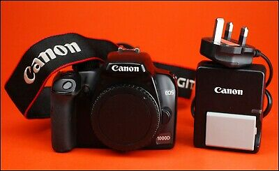 Canon EOS 1000D DSLR Camera Sold With Battery, & Charger & Shoulder / Neck Strap