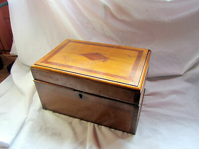An Antique Wooden Box With Removable Trays