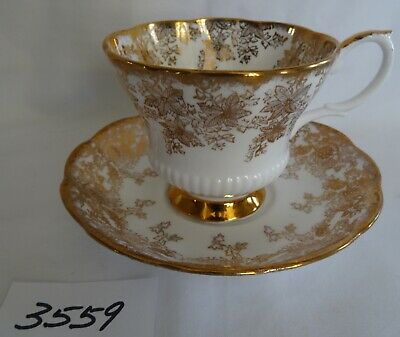 Royal Albert Cup Saucer all Gold Floral bone china England  gold rims and foot