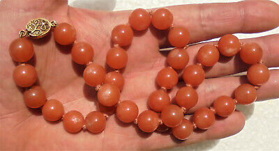 Fine Chinese orange russet jade (?) bead necklace - silver clasp