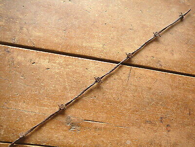 UPHAMS TWO POINT SNAIL BARB on   HALF ROUND LINE  - ANTIQUE BARBED BARB BOB WIRE