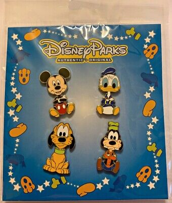 Disney Parks 4 pin set Mickey Donald Goofy Pluto - booster pack - Sealed NEW