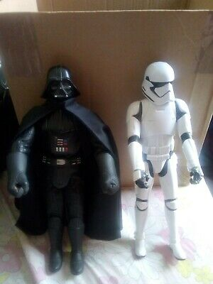 Star Wars Figures Darth Vader and a Storm Trooper.