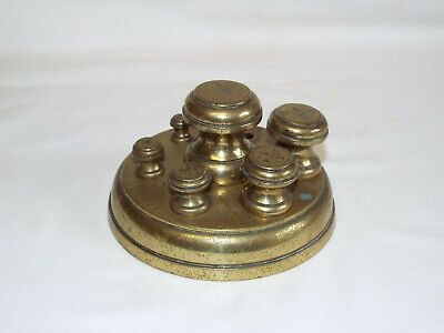 Antique Victorian brass peg weights in stand with VR excise marks.