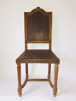 Antique French oak chair with embossed leather seat and back.