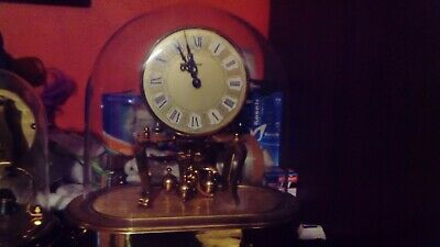 Vintage torsion anniversary 400 day wind-up mechanical mantel clock in perplex