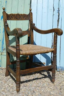 Victorian Jacobean Arts And Crafts Elbow Chair Heavily Carved Oak Rush Seat Chic