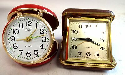 2 Vintage MECHANICAL Cased Travel Alarm Clocks By ELGIN And ESTYMA WORKING - G27