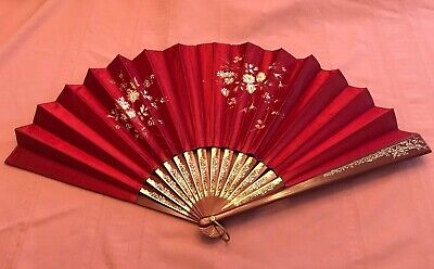 Antique hand-painted silk fan. Floral design, deep red, gold and silver details