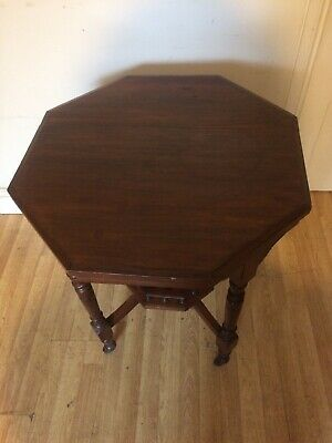 Edwardian American walnut octagonal side/occasional table with lower gallery.