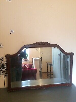 Late Victorian Beval edged mahogany carved over mantle mirror