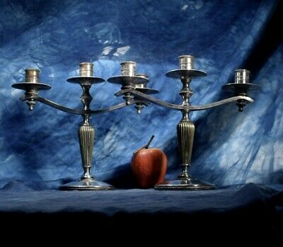 Antique / vintage Pair of heavy silver plated beautiful candlesticks  .