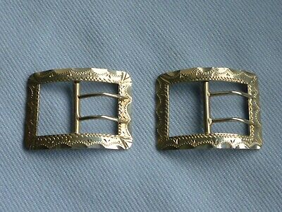 A beautiful pair of small Victorian (1897) decorative SOLID SILVER buckles