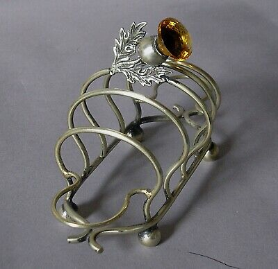 Vintage EPNS 4 slice Silver plated toast rack with amber glass Thistle finial.