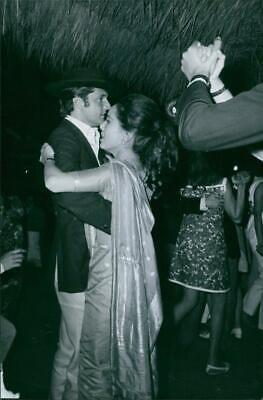 Dewi Sukarno dancing with a man in the dance party. - Vintage photo