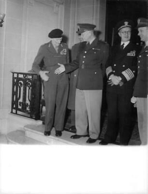 Dwight Eisenhower shook hands with his fellow uniformed military men. - Unique V