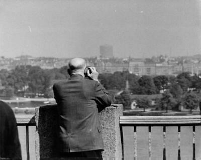 """American politician Dwight David """"Ike"""" Eisenhower standing on a roof top and loo"""